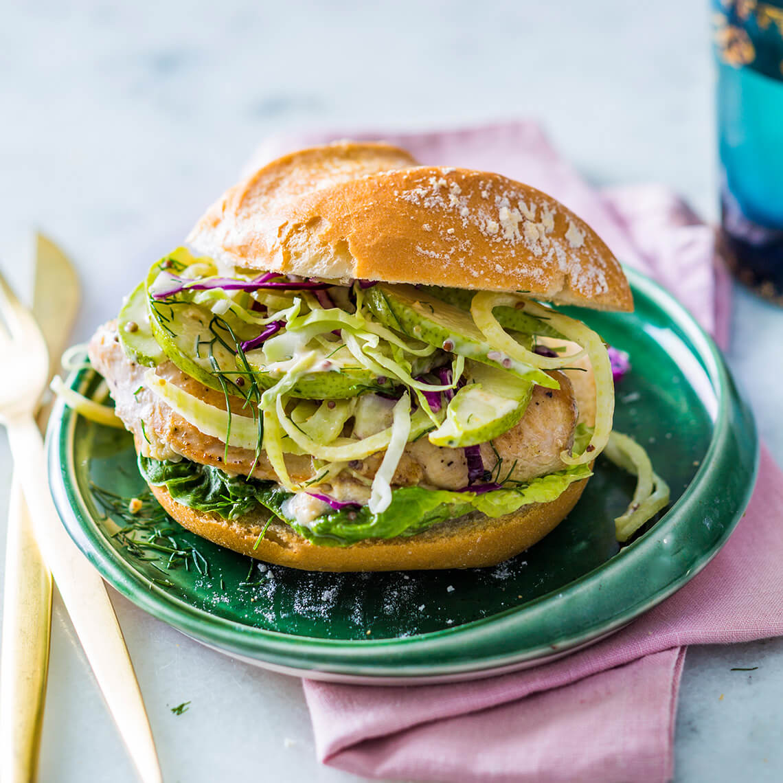 Gorgonzola-stuffed chicken burgers with pickled pear slaw